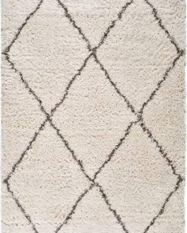 Béžový koberec Universal Lynn Lines, 135 x 190 cm
